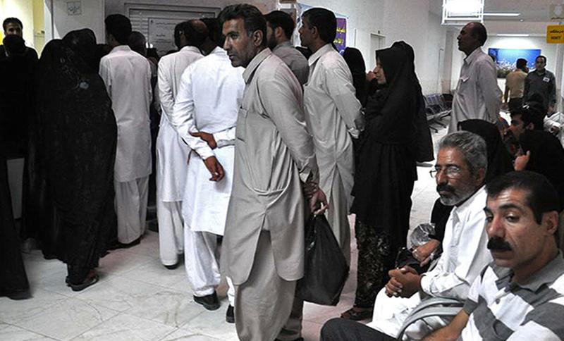 Iranian Baluchi citizens wait in long queues for ultrasound scans