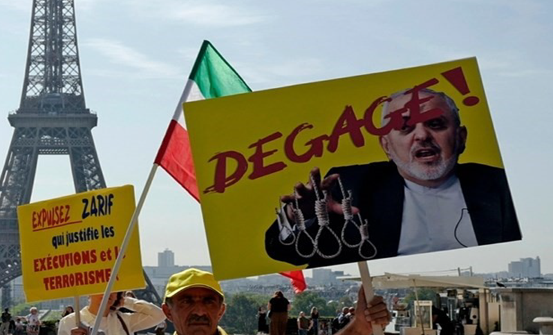 Hundreds of supporters of the MEK protest in Paris against Zarif