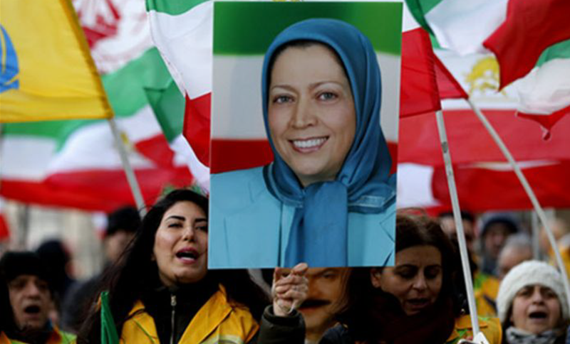 An MEK supporter holds a placard of Maryam Rajavi, the President-elect of the NCRI during a rally in London.