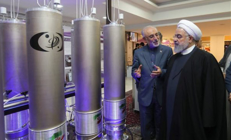 Iranian President Hassan Rouhani (3rd Left) is shown nuclear technology in Tehran, Iran