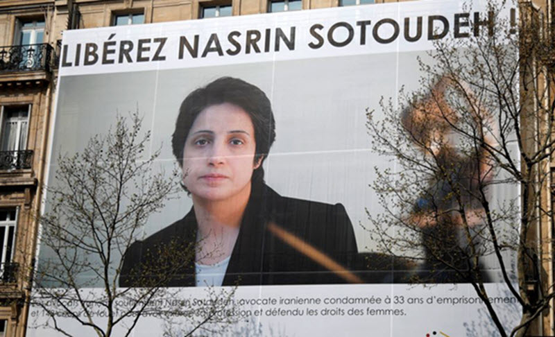 A banner with a giant portrait of jailed Iranian lawyer Nasrin Sotoudeh is seen on the headquarters of the French National Bar Council