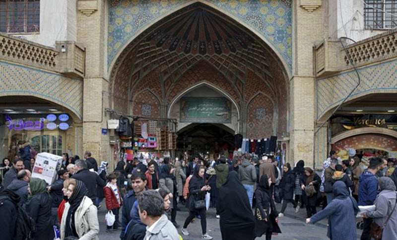 People walk around the Grand Bazaar in Tehran, Iran