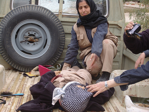 A woman resident of Ashraf shut by Iraqis on April 8 attack is being carried away from the scene