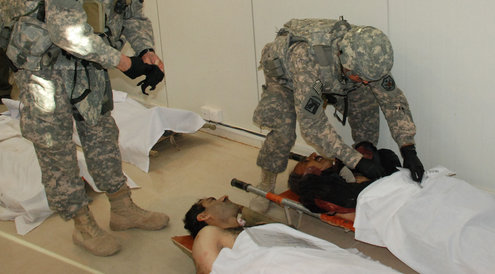 US forces in Camp Ashraf examining the bodies of killed residents